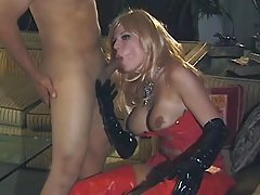 Shemale in latex sucks strong cock