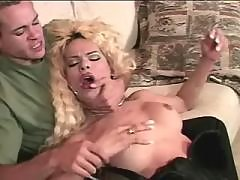 Blond TS & guy in oral fun outdoors