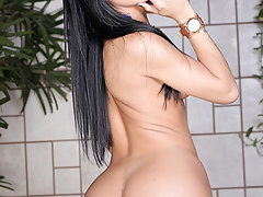 The gorgeous and horny Bruna Butterfly loves toying her little tight shemale ass-hole!